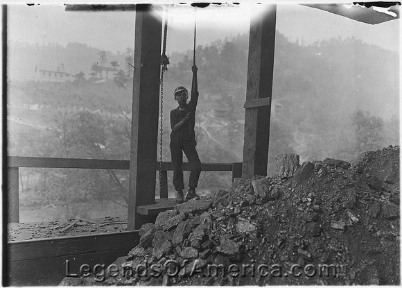 Welch, Wv -Young boy around 13 working the trip rope for Welch Mining in 1908