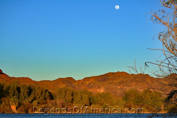 Moon rises over the Colorado River, Buckskin Mountain State Park, Arizona looking into California.