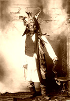 Geronimo, Apache Warrior, standing with headdress