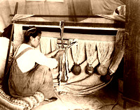 Chilkat woman weaving blanket