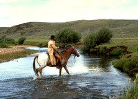 Horseback Rider, WY crossing a riverWYblm2008