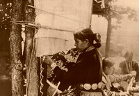 Navajo Indian woman weaving.